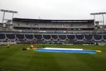 The new West Stand in the background with the covers are on the pitch as rain delays the start of play on day two. 1st Test: New Zealand v England at Jade Stadium, Christchurch, 13-17 March 2002 (14 March 2002).