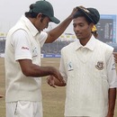 Shafiul Islam is awarded his Test cap by Shahadat Hossain