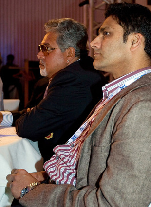 Vijay Mallya and Anil Kumble wait for Eoin Morgan's name to come up, Mumbai, January 19, 2010
