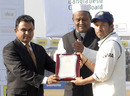 BCB President AHM Mustafa Kamal presents a memento to Sachin Tendulkar for becoming the first batsman to cross 13,000 runs in Test cricket, Bangladesh v India, 1st Test, Chittagong, 5th day, January 21, 2010