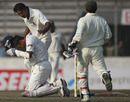 Shahadat Hossain checks on Rahul Dravid after felling him with a bouncer