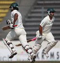 Tamim Iqbal and Junaid Siddique run across during their 200-run stand