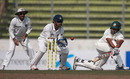 Tamim Iqbal sweeps as MS Dhoni and Virender Sehwag look on