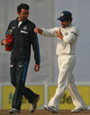 Sachin Tendulkar walks off with physio Nitin Patel, after injuring himself while attempting to take a catch