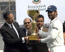 MS Dhoni receives the trophy after winning the series 2-0, Bangladesh v India, 2nd Test, Mirpur, 4th day, January 27, 2010