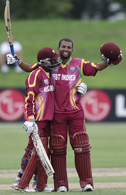 Yannic Cariah is cheered by Jermaine Blackwood on reaching his hundred