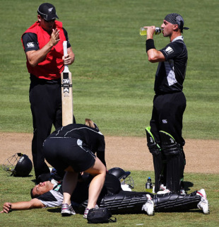 Peter Ingram has a drink while Ross Taylor gets treatment for a sore back, New Zealand v Bangladesh, 1st ODI, Napier, February 5, 2010