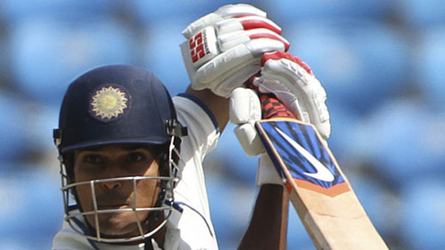 S Badrinath opens the face of the bat