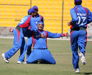 Hamid Hassan sinks to his knees at the moment of victory for Afghanistan, Afghanistan v Scotland, ICC World Twenty20 Qualifiers, February 10, 2010