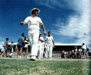 Mike Gatting leads his rebel side onto the field for the tour opener