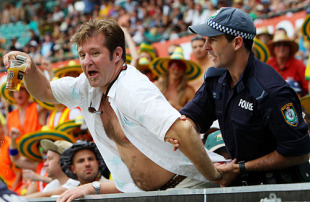 A spectator is taken away by a security staff, Australia v West Indies, 3rd ODI, Sydney, February 12, 2009