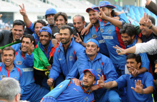 The victorious Afghanistan team strikes a happy pose, United Arab Emirates v Afghanistan, ICC World Twenty20 Qualifier, Super Four, Dubai, February 13, 2010