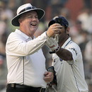Steve Davis has a laugh while checking the light meter with MS Dhoni