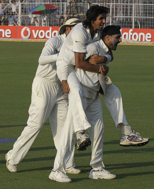 Ishant Sharma and Harbhajan Singh celebrate, India v South Africa, 2nd Test, Kolkata, 5th day, February 18, 2010