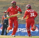 Singapore openers Buddika Mendis and Chetan Suryawanshi take a run during their 95-run stand, Bahrain v Singapore, ICC World Cricket League Division Five, Nepal, February 20, 2010