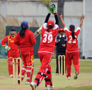 China Women's Yu Miao is caught behind by Hong Kong Women's Emma Phillips off the bowling of Keenu Gill during an international friendly played at the Kai Tak Cricket Ground