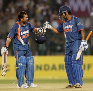 Sachin Tendulkar is congratulated by MS Dhoni after rewriting the record books, 2nd ODI, Gwalior, February 24, 2010