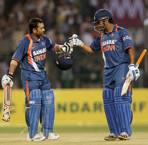 Sachin Tendulkar is congratulated by MS Dhoni after rewriting the record books