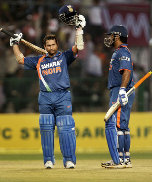 MS Dhoni is happy as Sachin Tendulkar reaches 200 in the last over, 2nd ODI, Gwalior, February 24, 2010