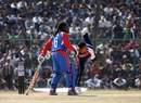 Basant Regmi bowls as Carl Wright looks on, Nepal v USA, World Cricket League Division 5, Nepal, February 26, 2010
