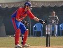 Thomas le Lievre breaks the stumps, Fiji v Jersey, ICC World Cricket League Division 5, February 27, 2010