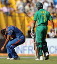 Yusuf Pathan is in pain after a collision with Hashim Amla