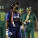 A disappointed M Vijay trudges off