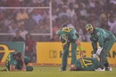 AB de Villiers and Jacques Kallis are on the ground after colliding when going for a catch