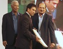 Sachin Tendulkar holds an autographed bat presented to him, as Ajit Wadekar and Garry Sobers look on, Mumbai, March 4, 2010