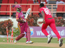 Dwayne Smith is bowled by Shingirai Masakadza
