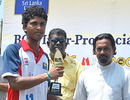 Dinesh Chandimal receives the Batsman of the Tournament award