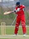 Vikash Vaswani cuts the ball during his innings of 50 against China