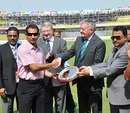 Habibul Bashar, the former Bangladesh captain, receives a memento from ICC president David Morgan after announcing his retirement, Dhaka, March 23, 2010