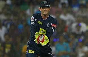 Adam Gilchrist watches a ball speed to the boundary