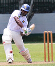 Mahela Udawatte drives during his aggressive 90
