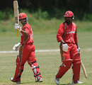 Ashish Bagai raises his bat after reaching fifty