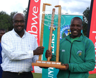 Ozias Bvute, Zimbabwe Cricket's managing director, hands the trophy to Hamilton Masakadza, Mountaineers v Mid West Rhinos, Faithwear Cup final, Mutare, April 10, 2010