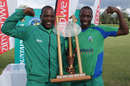 Hamilton Masakadza and Shingirai Masakadza with the trophy
