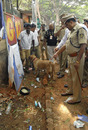 A policemen and a bomb-squad inspect the area around the Chinnaswamy Stadium, Royal Challengers Bangalore V Mumbai Indians, IPL, Bangalore, April 17, 2010