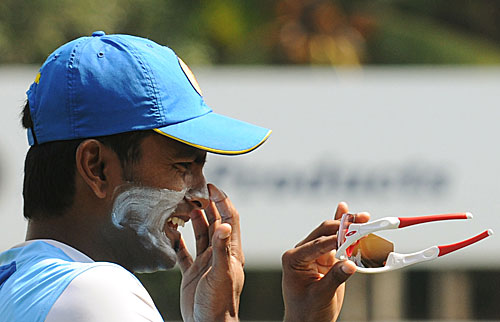 Chinthaka Jayasinghe takes a break during training