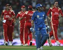 Sachin Tendulkar walks back after being dismissed