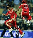Virat Kohli celebrates after running out Shikhar Dhawan