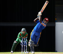 Martin Nurse goes over the top, Barbados v Bangladesh, ICC World Twenty20 warm-up, Kensington Oval, April 27, 2010