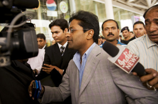 Lalit Modi arrives at the domestic terminal in New Delhi, April 28, 2010