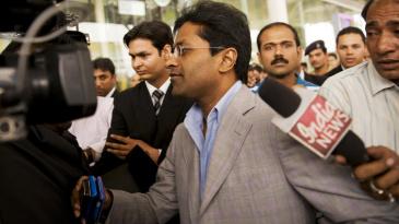 Lalit Modi arrives at the domestic terminal in New Delhi