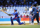 Asghar Stanikzai lofts one of his three sixes as MS Dhoni looks on