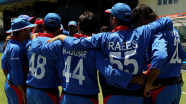 The Afghanistan team huddles together before taking the field