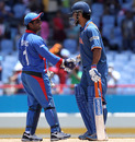 MS Dhoni and Mohammad Shahzad shake hands at the end of the game