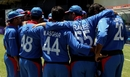 The Afghanistan team huddle before taking the field against India
