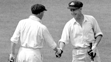 Don Bradman congratulates Arthur Morris on reaching his century